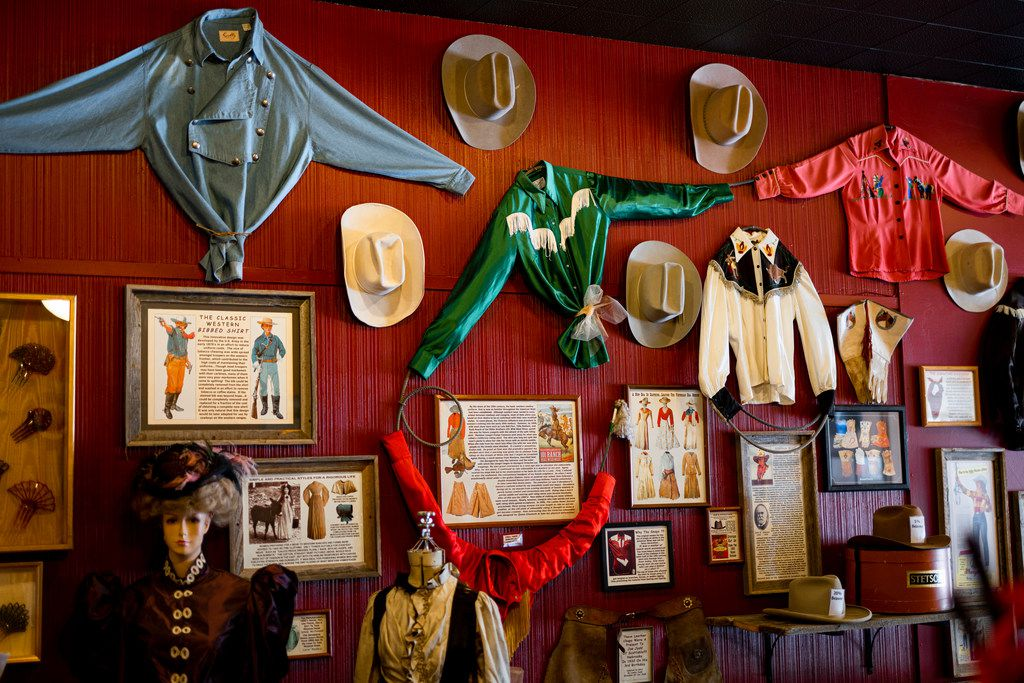 Western wear hangs on display at the Cowgirls of the West Emporium in Cheyenne, Wyo. The emporium and the next-door museum offer fun facts about pioneering Western women.