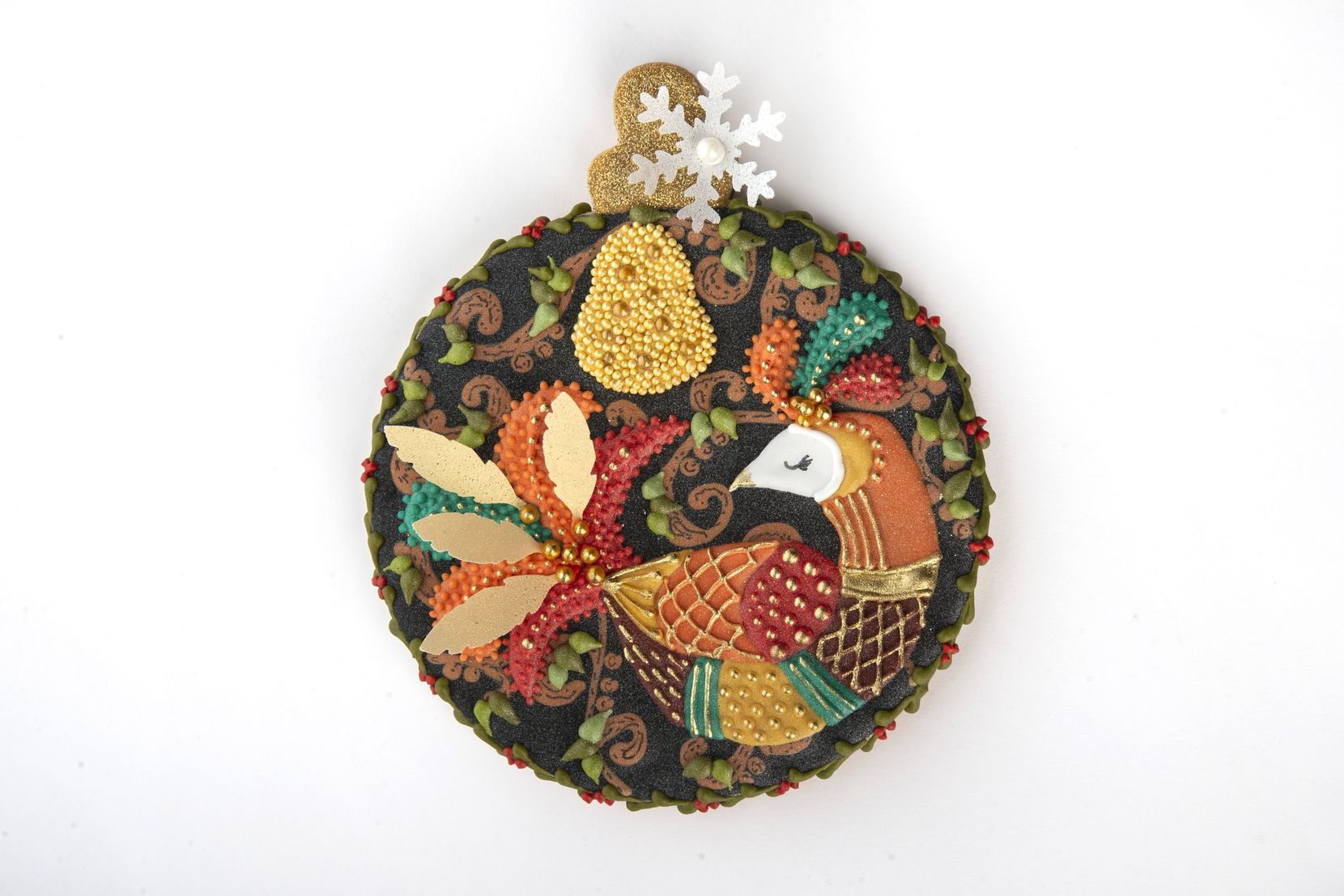 The First Day of Christmas Ornament (Partridge in a Pear Tree), made by Suzanne Whitbourne, won the cookie man category at the annual Holiday Cookie Contest hosted by The Dallas Morning News.