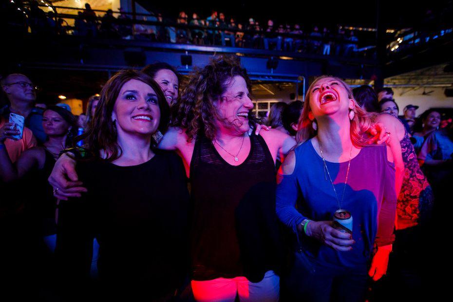 Meryl Evans (center) laughs with her friends Jennifer Peterson (left) and Jennifer Sheiner during a concert.