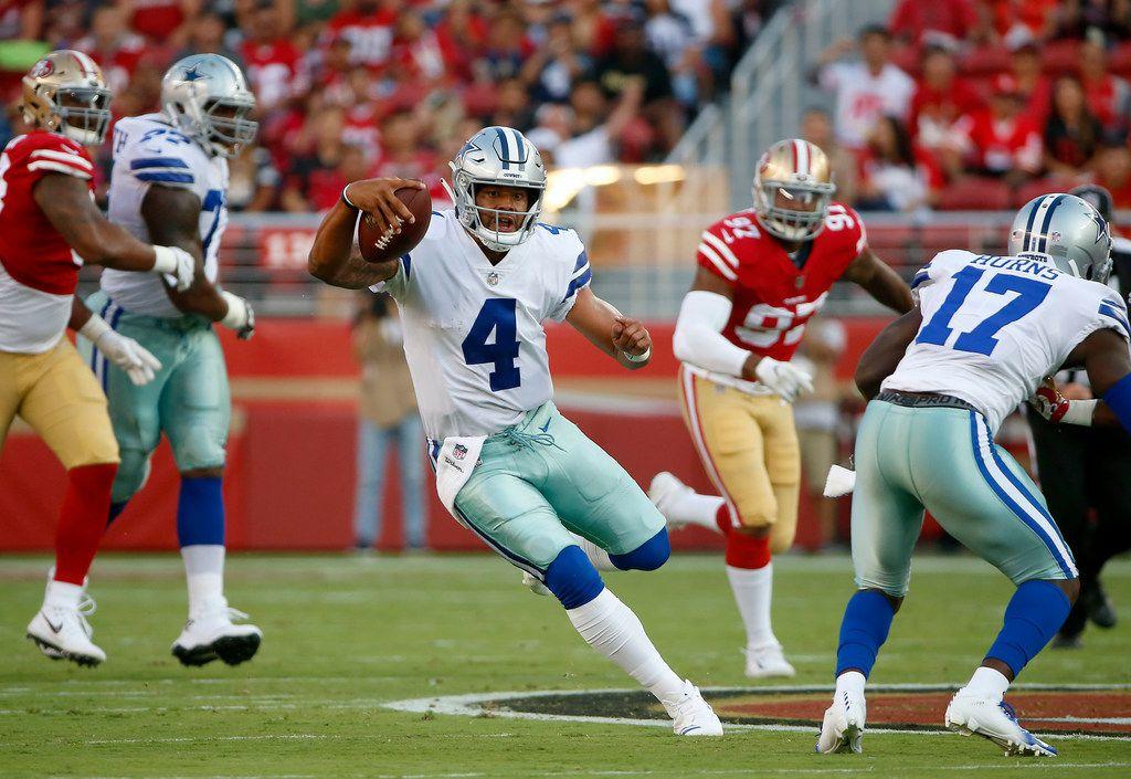Dallas Cowboys quarterback Dak Prescott (4) runs for a first down against San Francisco 49ers during the first quarter of the pre-season game at Levi's Stadium in Santa Clara, Calif., Thursday, Aug. 9, 2018. (Jae S. Lee/The Dallas Morning News)