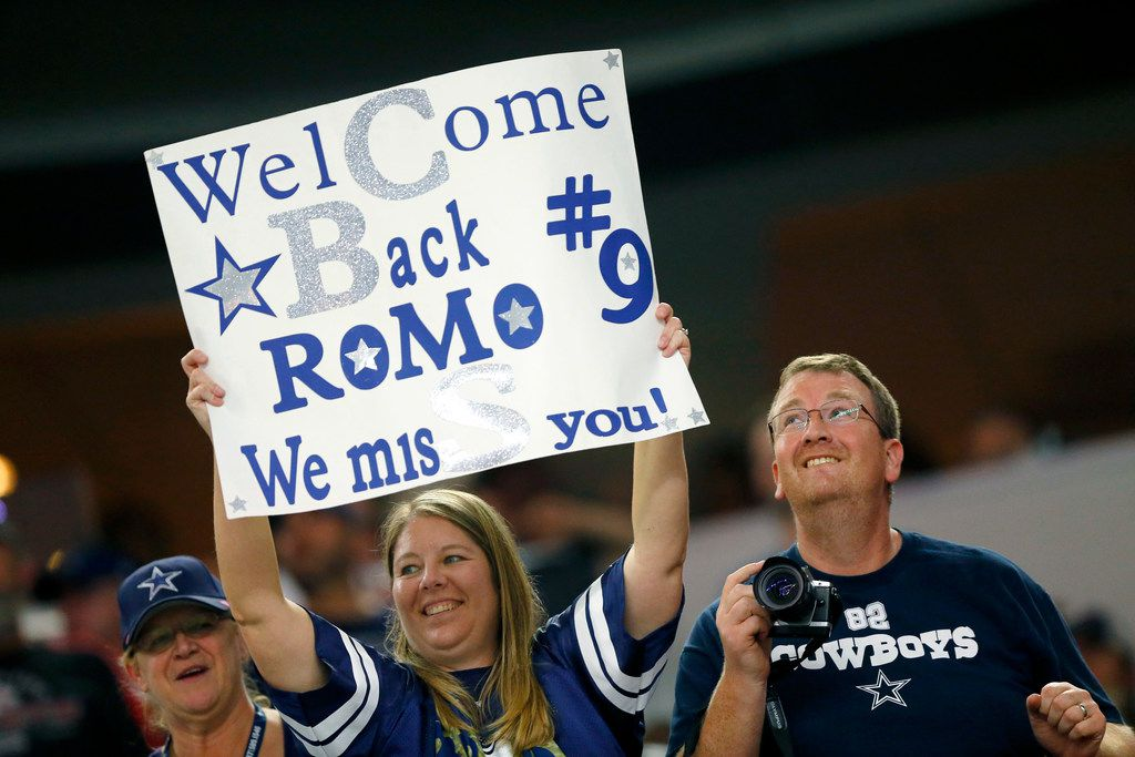 FILE - A Dallas Cowboys fan welcomes former quarterback Tony Romo back to AT&T Stadium during the Kansas City Chiefs game in Arlington, Texas, Sunday, November 5, 2017. (Tom Fox/The Dallas Morning News)