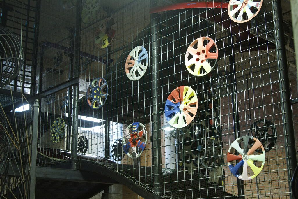 Hubcaps, painted by children as part of an art project are displayed throughout the lower level at at Spark. They were used to teach children about negative and positive space in art.