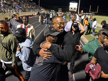 Denver Broncos linebacker and former DeSoto High School player, Von Miller, receives a hug from aunt Cynthia Williams as she congratulates him after he had his DeSoto High School football jersey retired during a ceremony at halftime of the game between Grand Prairie High School and DeSoto High School at Eagle Stadium in DeSoto, Friday night Oct. 18, 2019. Ben Torres/Special Contributor