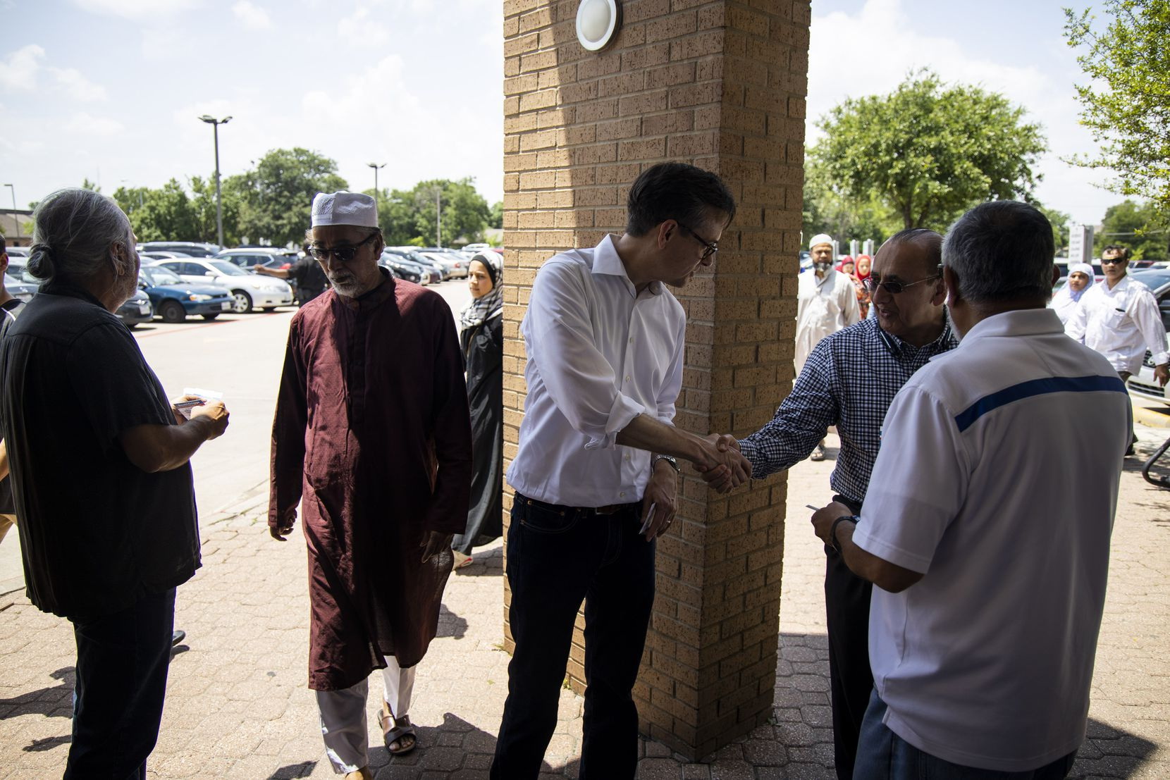 Scott Griggs shakes hands with worshippers at the Islamic Association of North Texas mosque in Richardson before an afternoon prayer service. Thousands of North Texans, many of them from Dallas, attend the services.  (Shaban Athuman/Staff Photographer)