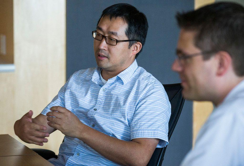 UT-Arlington associate professor of computer science and engineering Chengkai Li (left) and associate professor of computer science and engineering Christoph Csallner talk about how to identify fake news.