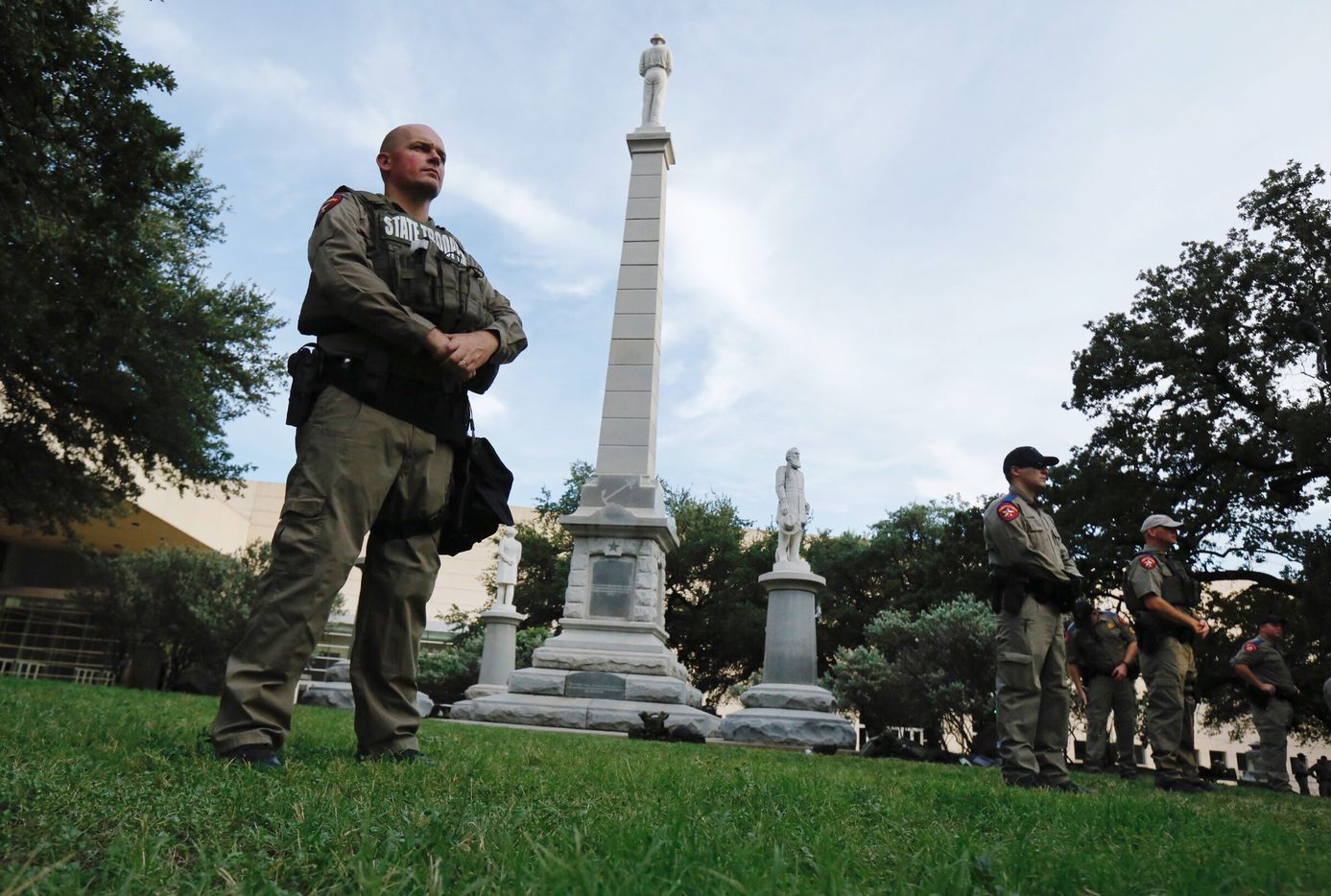 Texas state troopers guard the Confederate War Memorial before the March Against White Supremacy rally at Pioneer Park Cemetery.