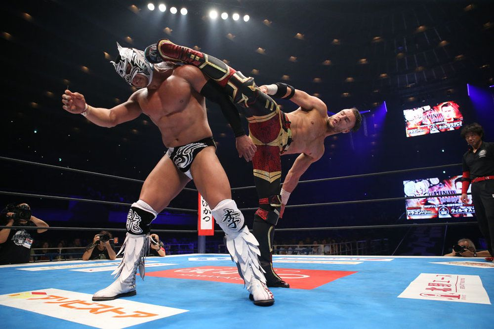 Will Ospreay kicks his opponent Dragon Lee at NJPW Dominion 6.9, June 9, 2019.