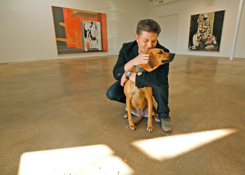 Kenny Goss is pictured with his dog Dixie at the Goss-Michael Foundation on Wycliff Avenue in Dallas, photographed in Dallas on Thursday, February 23, 2017. (Louis DeLuca/The Dallas Morning News)