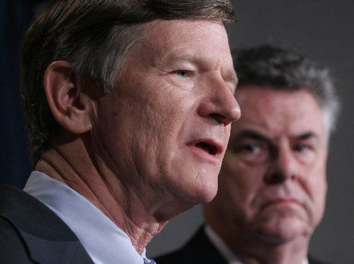 Rep. Lamar Smith, R-Texas (left) accompanied by Rep. Peter King, R-N.Y, speaks to reporters on Capitol Hill.