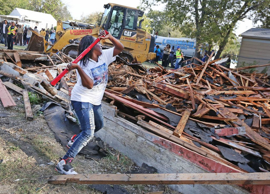 Cynthia King, great aunt of Shavon Randle, uses a sledgehammer to put the finishing touches on the demolition of the structure at 2208 E. Kiest Blvd. in Oak Cliff, where the body of 13-year-old Shavon Randle was found in July.