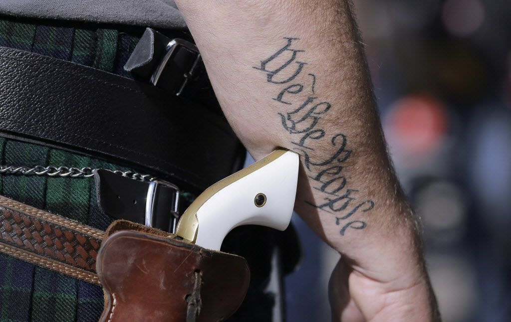 Scott Smith, a supporter of open carry gun laws, wears a pistol as he prepares for a rally at the Capitol, Monday, Jan. 26, 2015, in Austin, Texas. (AP Photo/Eric Gay) 02122015xNEWS