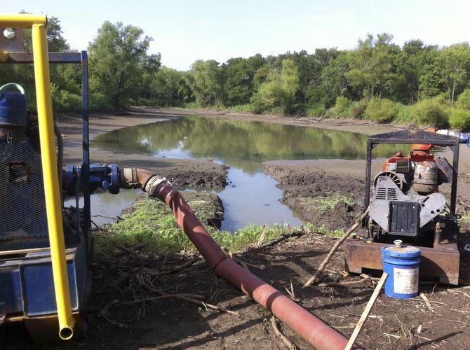 Pumps pulled water from a pond in the Great Trinity Forest until a city inspector halted the draining. The free water was used to control dust during work on a golf course.