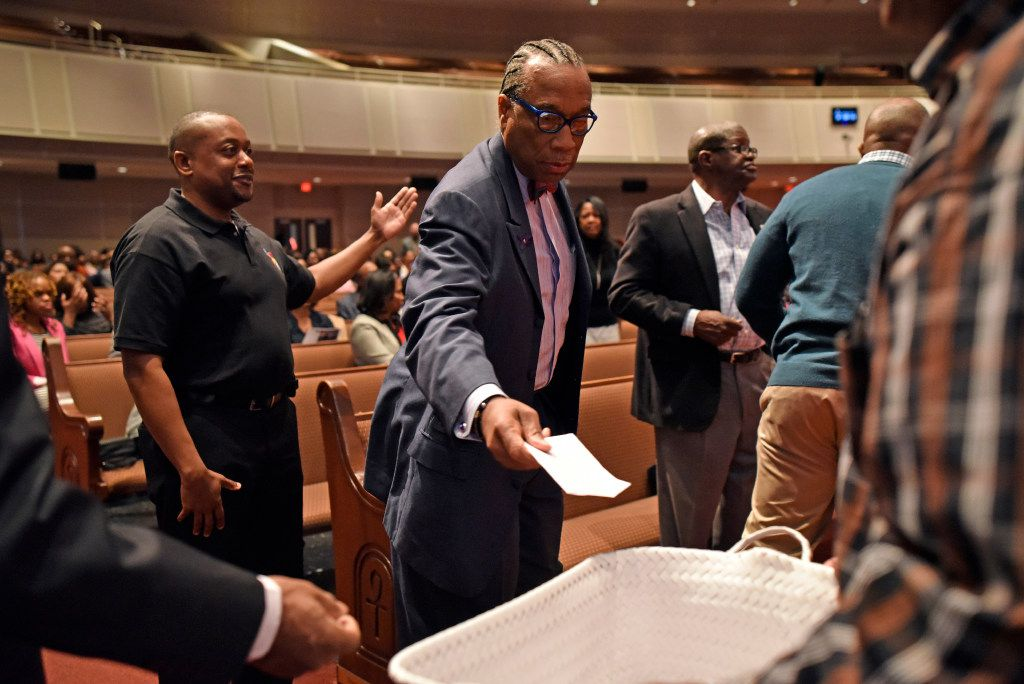 Dallas County Commissioner John Wiley Price places a check donation into a basket during a Sunday service at Friendship-West Church in South Dallas, Feb. 26, 2017. Ben Torres/Special Contributor