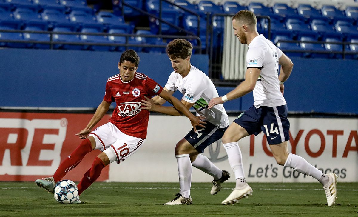 Arturo Rodriguez, USL-1 Final MVP, shields off two Greenville defenders in the USL League One Final won by North Texas SC, October 19, 2019.