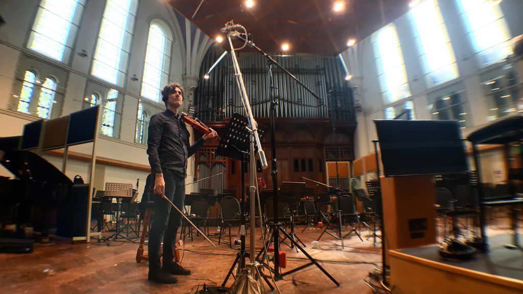 Dallas native composer Daniel Hart in 2016, recording his score for Pete's Dragon at AIR studios in London. The film was directed by Dallas' David Lowery. Hart teamed with Lowery again to score 2018's The Old Man & the Gun, starring Robert Redford.