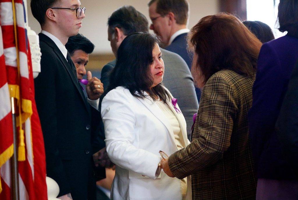 "Maria Rogers (center), mother of Linda ""Michellita"" Rogers, receives words of encouragement from Rep. Thresa ""Terry"" Meza (right) of Irving/Grand Prairie following a resolution honoring the 12 yr-old girl who died when their home exploded following a natural gas leak a year ago. The family was in attendance when Representative Rafael Anchia, D-Dallas, introduced a House of Representatives resolution at the Texas State Capitol in Austin, Wednesday, February 27, 2019."