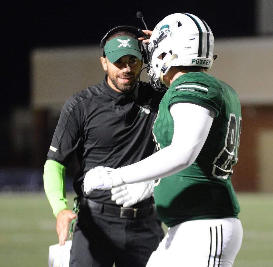 Tony Benedetto, who told The Dallas Morning News he was hired as Woodrow Wilson's head coach on Feb. 7, 2019, meets with a Mesquite Poteet player during the 2018 season.