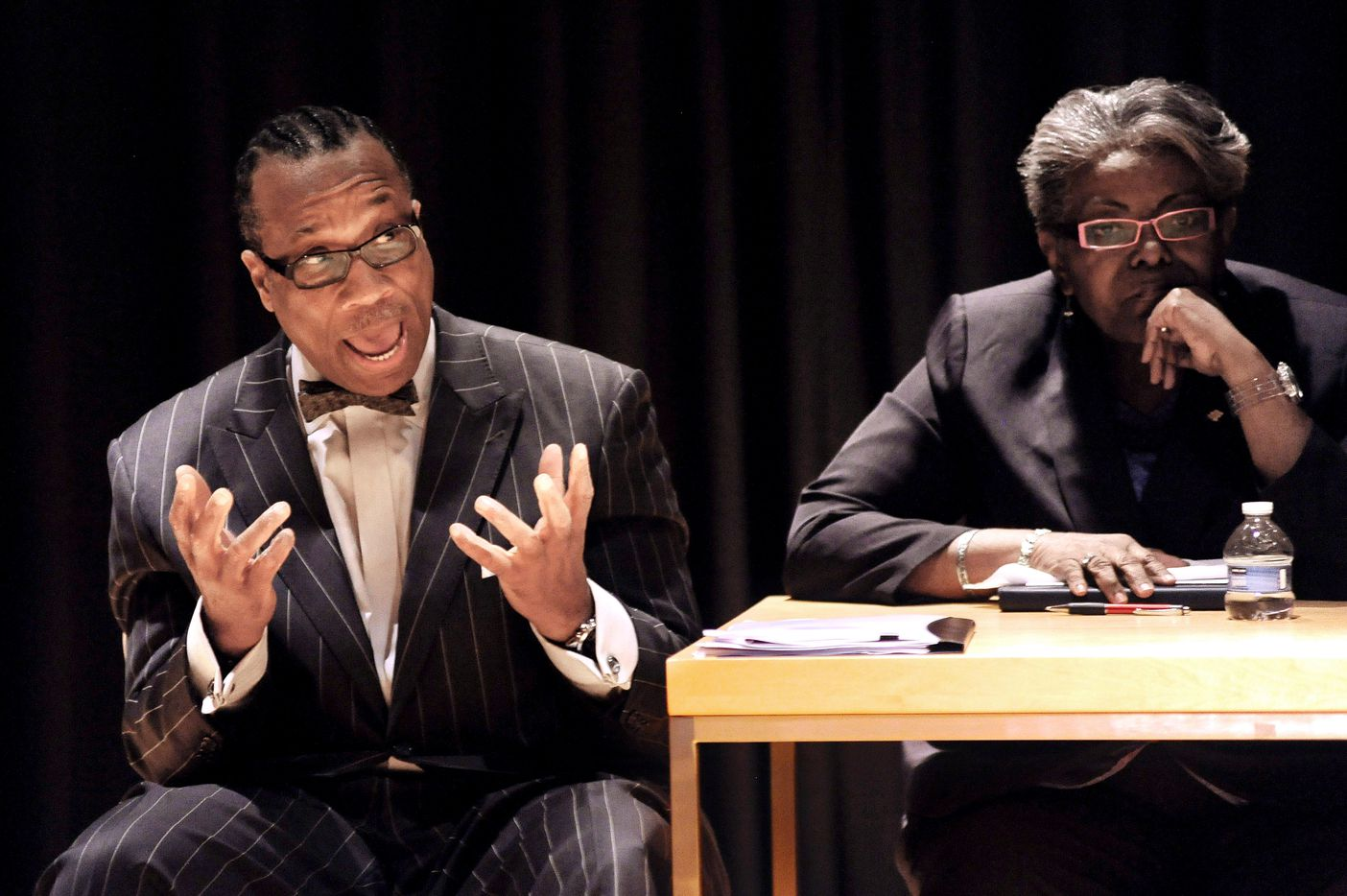 John Wiley Price, left, speaks during the debate at a forum for the District 3 commissioner's court seat, while Betty Culbreath awaits her turn to speak at the African American Museum in Dallas in March, 2012.