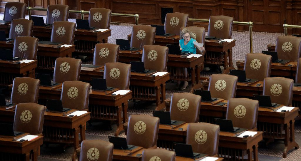Texas Rep. Donna Howard, D-Austin, worked at her desk as she waited for the House to convene last August during the Legislature's special session. in Austin.  (AP Photo/Eric Gay)