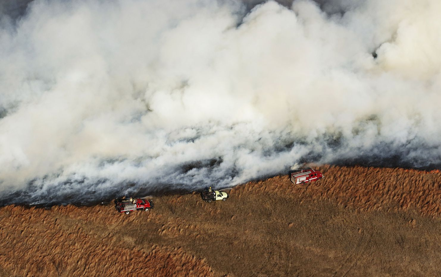 Fire crews tried to control a grass fire west of Fort Worth, Texas, on Monday January 22, 2018.