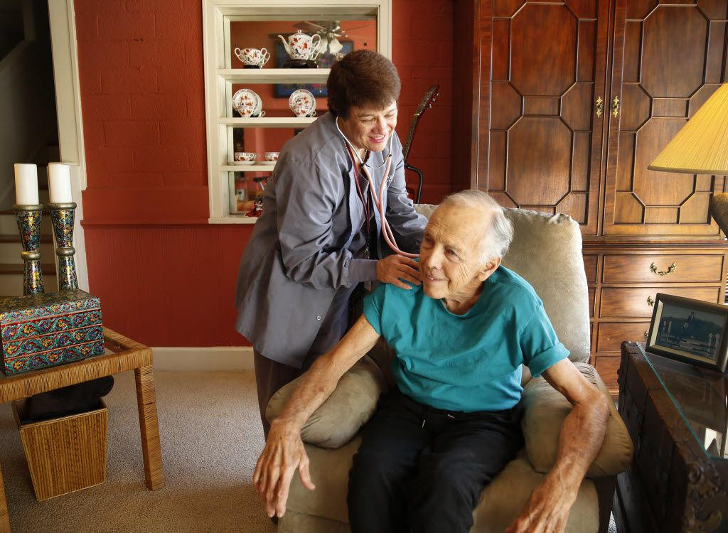 Encompass Health and Hospice case manager Lynn Duvall checked patient Robert Meece's blood pressure during a home check-up in Fort Worth in 2015.