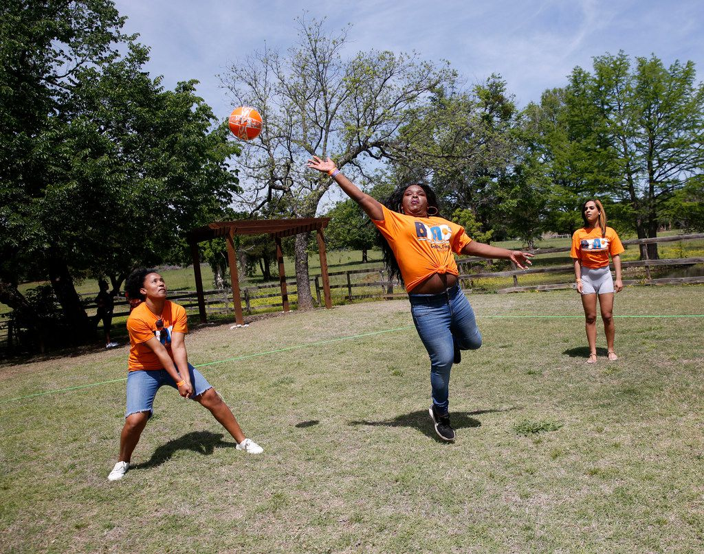 Ida H. (left) and Lauryn Reeder move to hit the ball during a game of volleyball at the picnic.