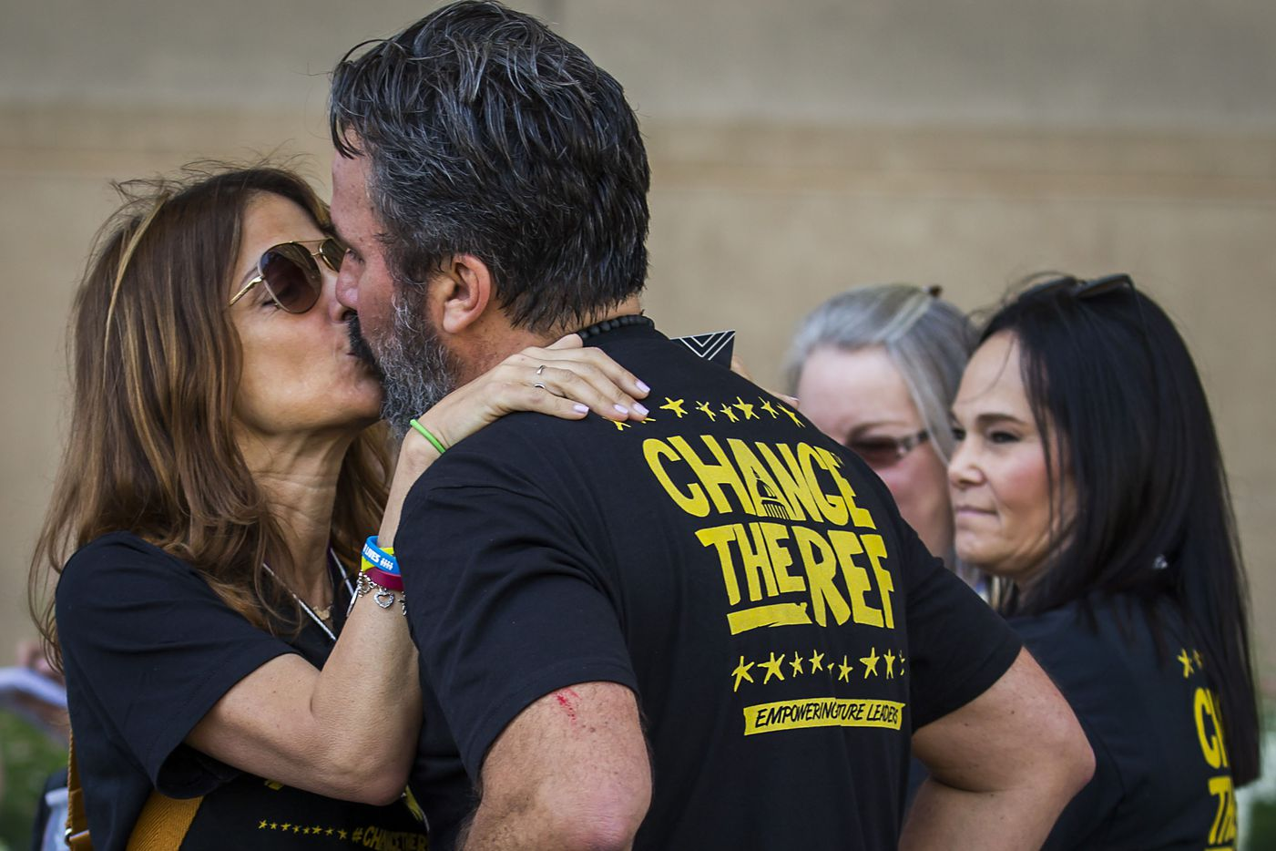 Manuel Oliver gets a kiss from his wife Patricia after speaking during a gun control demonstration outside Dallas City Hall organized by StudentsMarch.org during the NRA Annual Meeting & Exhibits at the Kay Bailey Hutchison Convention Center on Saturday, May 5, 2018, in Dallas. The Oliver's son Joaquin was one of the 17 victims of a mass shooting at Marjory Stoneman Douglas High School in Parkland, Florida. (Smiley N. Pool/The Dallas Morning News)