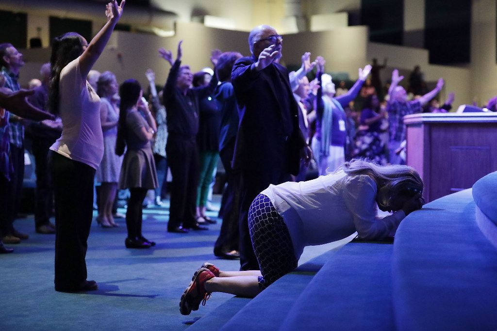 Worshippers prayed during a service at the International Church of Las Vegas last month before the arrival of  Donald Trump. (Chip Somodevilla/Getty Images)