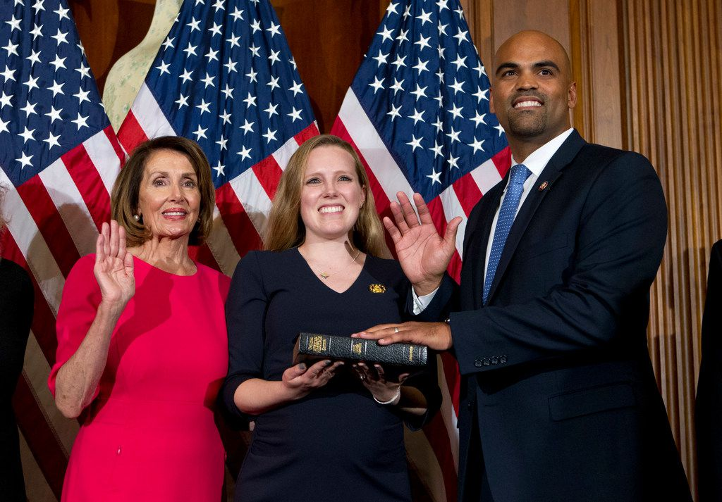 House Speaker Nancy Pelosi (left)  administers the House oath of office to Rep. Colin Allred, D-Texas, who is joined by his wife, Alexandra Eber, during a ceremonial swearing-in on Capitol Hill.
