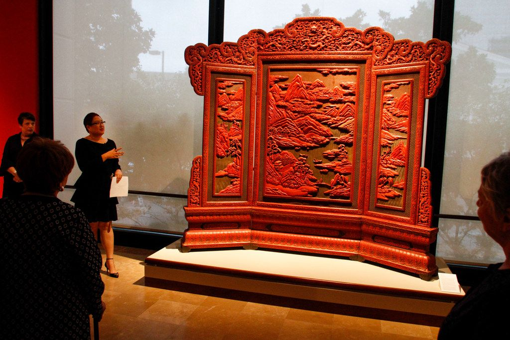 Senior Curator of Asian Art, Jacqueline Chao, shows members of the media a Lacquer screen from 19th to 20th century China at the Crow Museum of Asian Art in Dallas on Wednesday, September 26, 2018. (Brian Elledge/The Dallas Morning News)