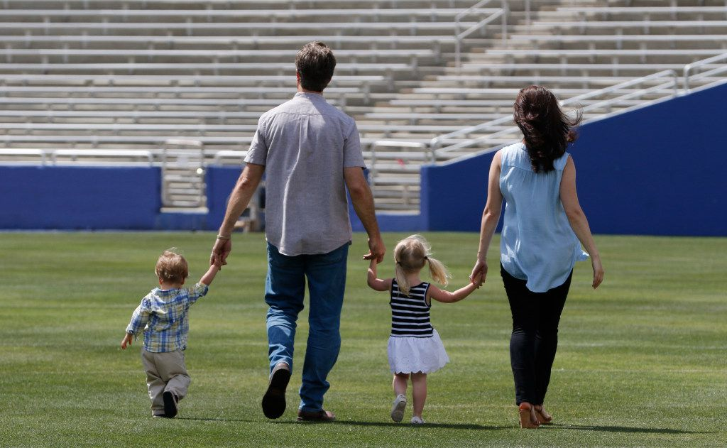 Michael Meredith, an American independent film director, screenwriter and producer, son of Cowboys great Don Meredith, walks with his wife, Amit Nizan Meredith, and their children, Walker, 18 months, left, and Marlowe, 2, at the Cotton Bowl in Fair Park in Dallas on Tuesday, June 13, 2017. Michael is working on a documentary about the 1960s Cowboys when his Dad played quarterback. (David Woo/The Dallas Morning News)