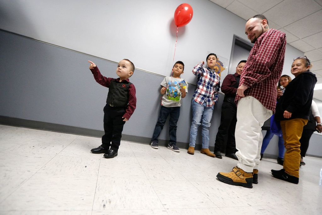 King Romero, 2, points to the courtroom before being adopted during National Adoption Day Dallas by Court Appointed Special Advocates at Henry Wade Juvenile Justice Center on Nov. 17, 2018.