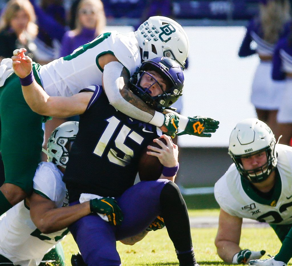 TCU Horned Frogs quarterback Max Duggan (15) is brought down by a swarm of Baylor Bears defenders during the first half of an NCAA football matchup between the Texas Christian University Horned Frogs and the Baylor Bears at Amon G. Carter Stadium in Fort Worth, Texas, on Saturday, No. 9, 2019.