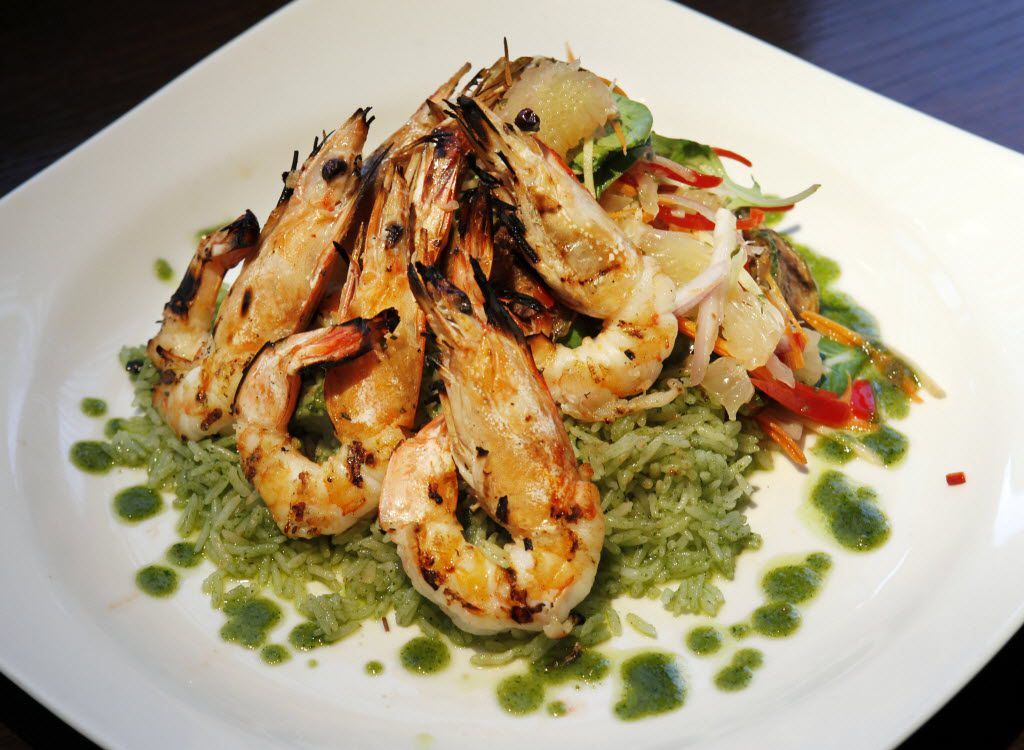Here are grilled tiger prawns: coconut-marinated Texas Gulf prawns with pomelo salad and cilantro-pesto rice, as prepared at the Malai Kitchen Restaurant in the West Village in Dallas.