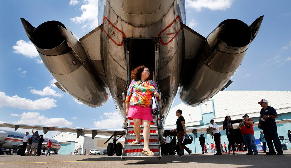 American Airlines gate agent Ester Mondragon walks off a retired MD-80.