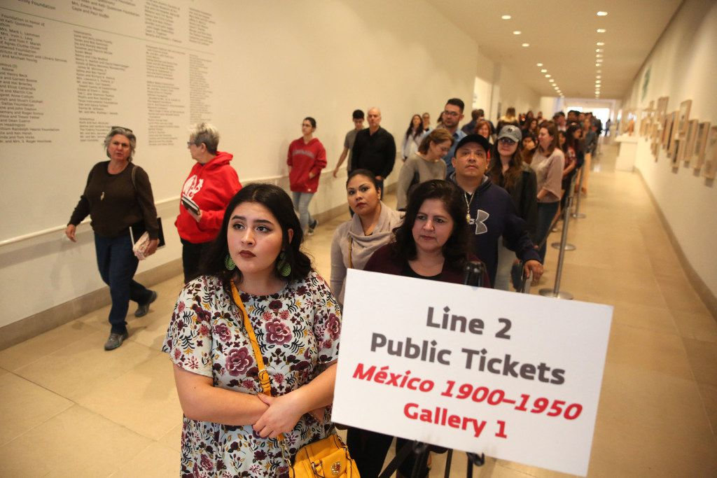 """Leslie Marrufozo (front) waits in line for the """"Mexico 1900-1950: Diego Rivera, Frida Kahlo, Jose Clemente Orozco, and the Avant-Garde"""" exhibit at the Dallas Museum of Art in Dallas on Tuesday, March 14, 2017."""