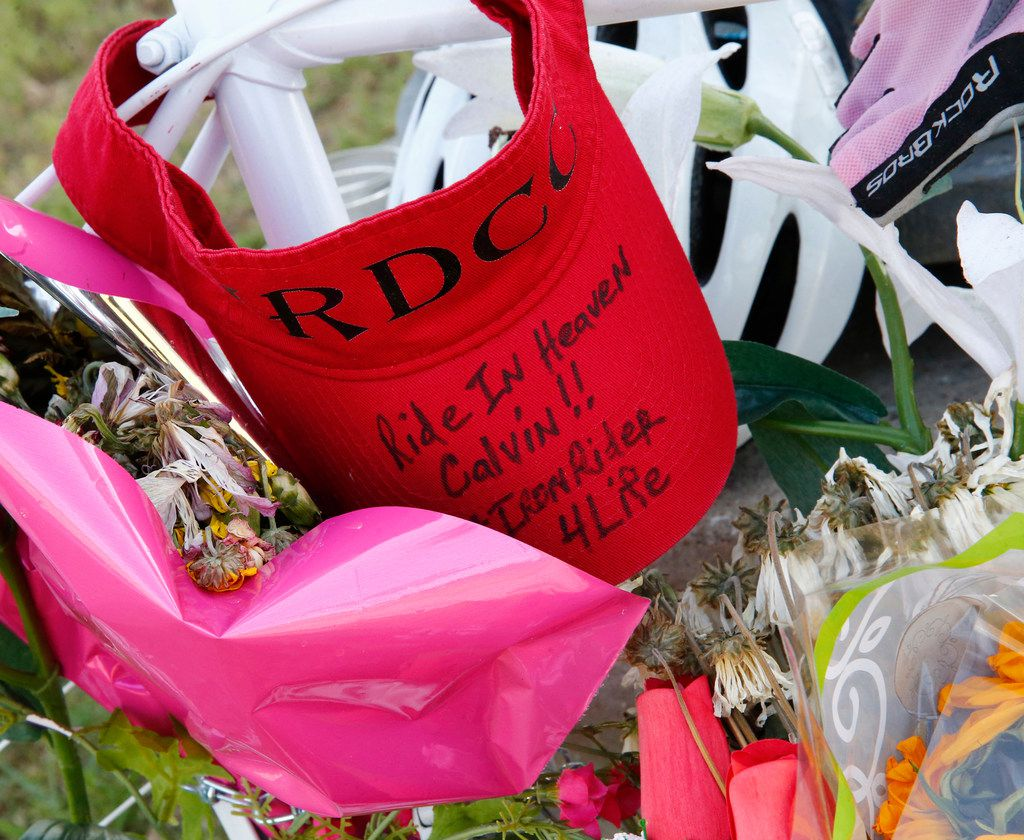 Messages and memorials are left at a ghost bike that sits at the southeast corner of Belt Line Road and Interstate 20 where Calvin Middleton of Cedar Hill was killed on his early morning ride in Grand Prairie.