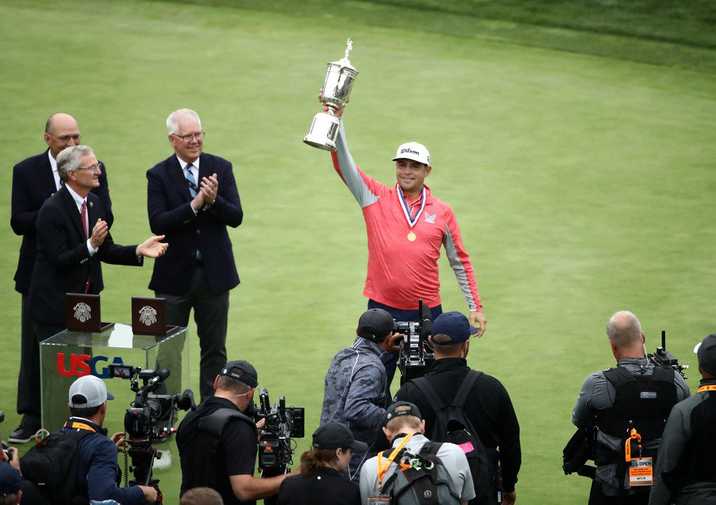Gary Woodland celebrates with the trophy after winning the 2019 U.S. Open at Pebble Beach Golf Links on June 16, 2019 in Pebble Beach, Calif.