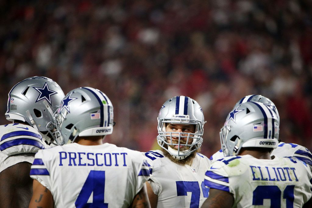 FILE - Cowboys center Travis Frederick (72) is pictured with teammates in the huddle during a game against the Arizona Cardinals at University of Phoenix Stadium in Glendale, Ariz., on Monday, Sept. 25, 2017. (Andy Jacobsohn/The Dallas Morning News)