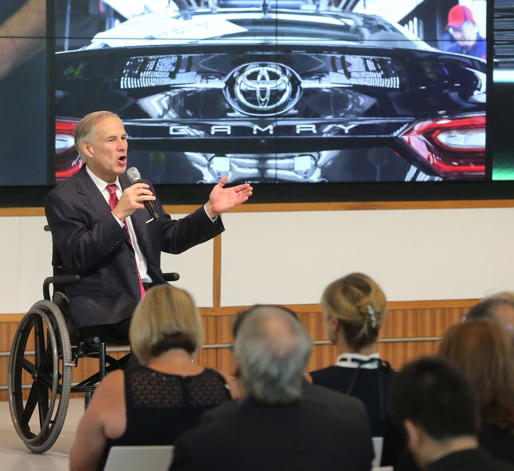 Texas governor Greg Abbott address the crowd during the grand opening ceremony of the Toyota headquarters in Plano, Texas, photographed on Thursday, July 6, 2017.