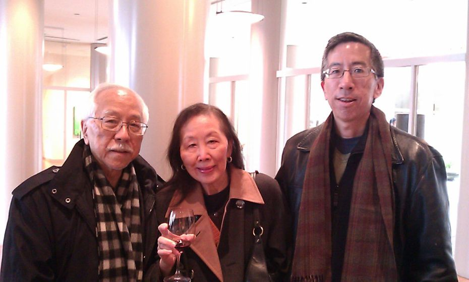 Thomas Huang (right) in an undated photograph with his parents.