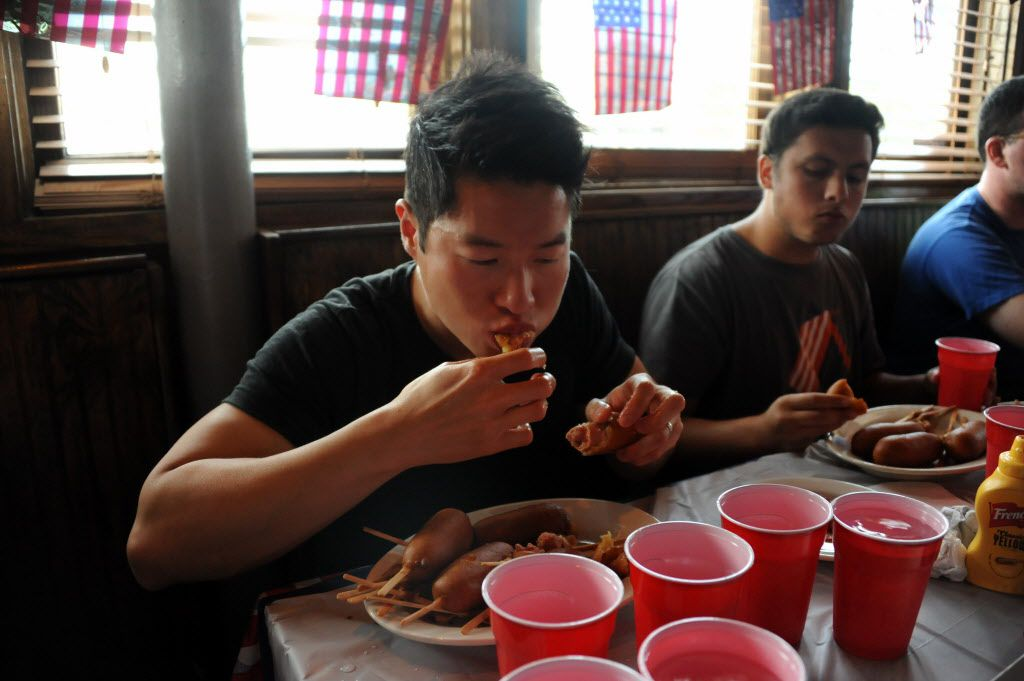 Andy Chu wins the contest for the second year in a row at the 7th annual Brass Knuckles Corn Dog Beatdown at The Libertine Bar on July 4, 2015.