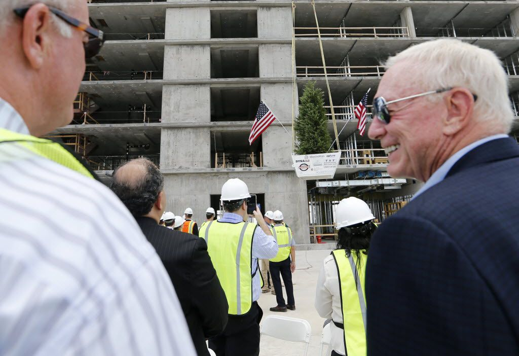 Dallas Cowboys owner and general manager Jerry Jones smiles as he talks to his son and Dallas Cowboys director of player personnel Stephen Jones during the topping out ceremony at the Omni Frisco Hotel at The Star in Frisco on Wednesday, July 27, 2016. (Vernon Bryant/The Dallas Morning News)