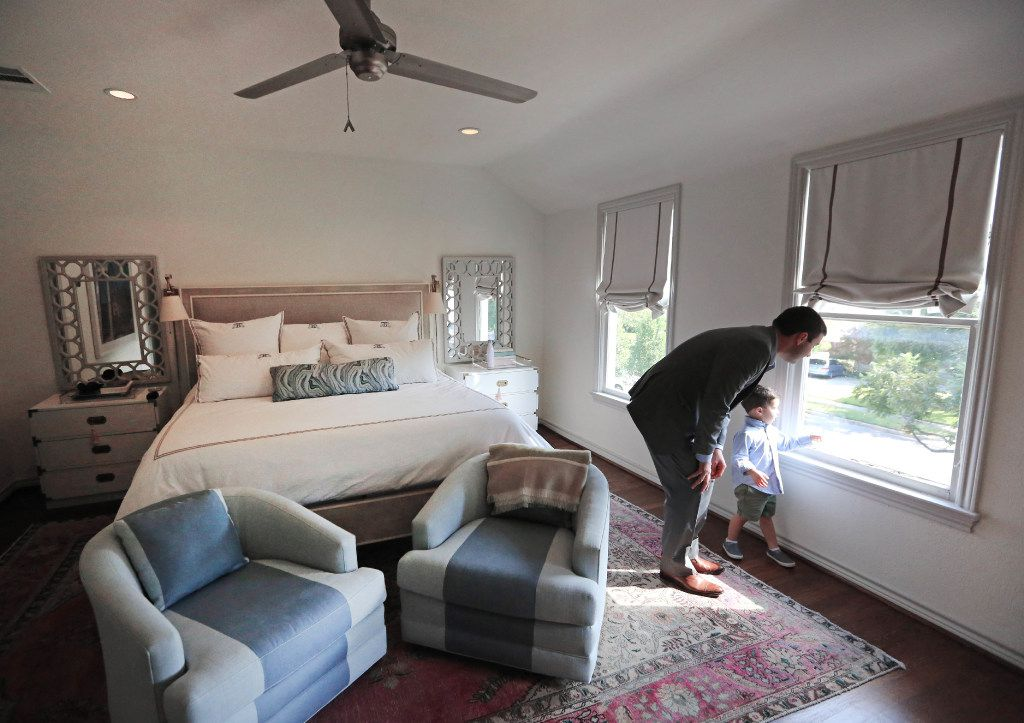 Tony Ruggeri and his son Michael look out the window in the master bedroom of their home at 6935 Lakeshore in Dallas.