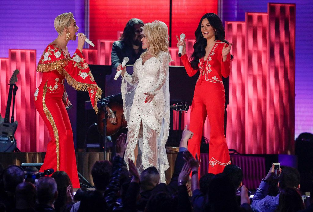 From left, Katy Perry, Dolly Parton and Kacey Musgraves perform during the 61st Grammy Awards at Staples Center in Los Angeles on Sunday, Feb. 10, 2019.