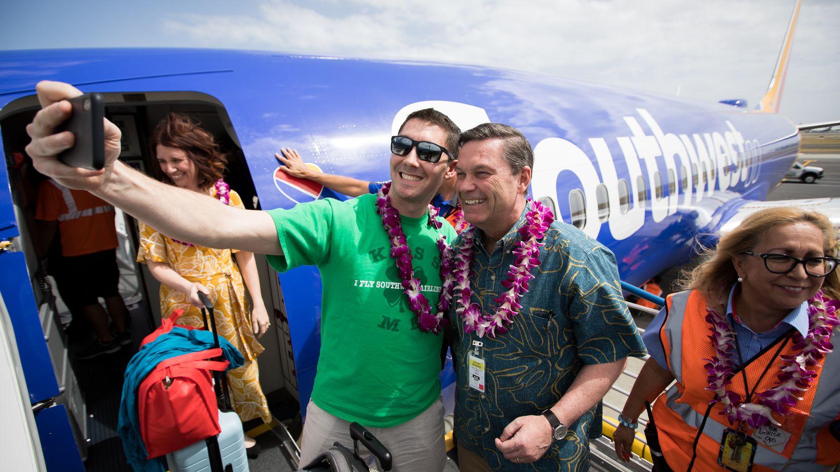 Southwest Airlines President Tom Nealon greets arriving passengers on the inaugural flight to Hawaii touches down in Daniel K. Inouye International Airport in Honolulu. // Stephen M. Keller, 2019