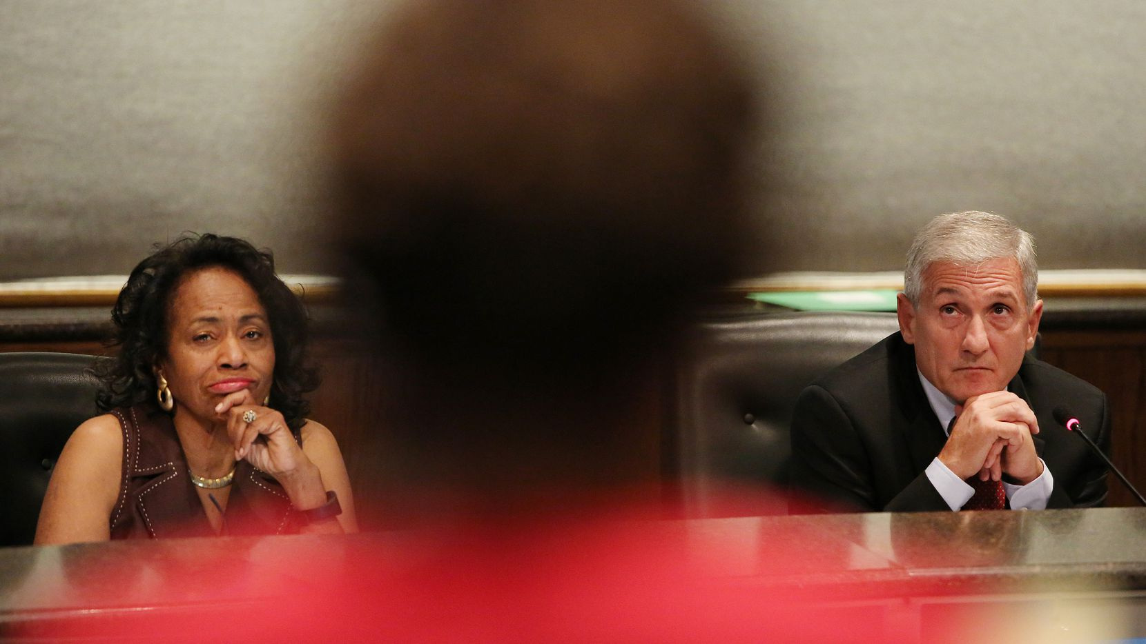 Trustee Joyce Foreman and board president Dan Micciche listen during a public hearing and board meeting of the Dallas Independent School District at the Dallas ISD headquarters in Dallas Friday.