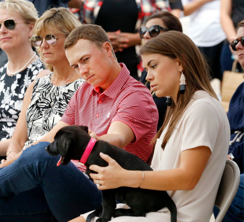 PGA golfer Jordan Spieth plays with he and his fiance Annie Verret's (right) new dog during a ribbon cutting ceremony for the Flag Pole Hill Park Playground, an all-inclusive playground near White Rock Lake in Dallas, Thursday, September 13, 2018. (from the press release) KOMPAN joined members of the City of Dallas, Jordan Spieth Family Foundation in celebrating the thoughtful design of the playground which encourages social interaction as well as physical and cognitive development of children of all ages and abilities. Each area of the park has graduated activities so that the playground activity challenges progress with the growth and ability levels of each individual child. Also involved in project were members of the City of Dallas, the Lake Highlands Junior Women's League, the Lake Highlands Exchange Club and For the Love of the Lake. (Tom Fox/The Dallas Morning News)