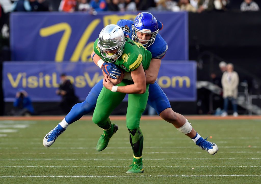 LAS VEGAS, NV - DECEMBER 16:  Leighton Vander Esch #38 of the Boise State Broncos tackles quaterback Justin Herbert #10 of the Oregon Ducks during the Las Vegas Bowl at Sam Boyd Stadium on December 16, 2017 in Las Vegas, Nevada. Boise State won 38-28.  (Photo by David Becker/Getty Images)