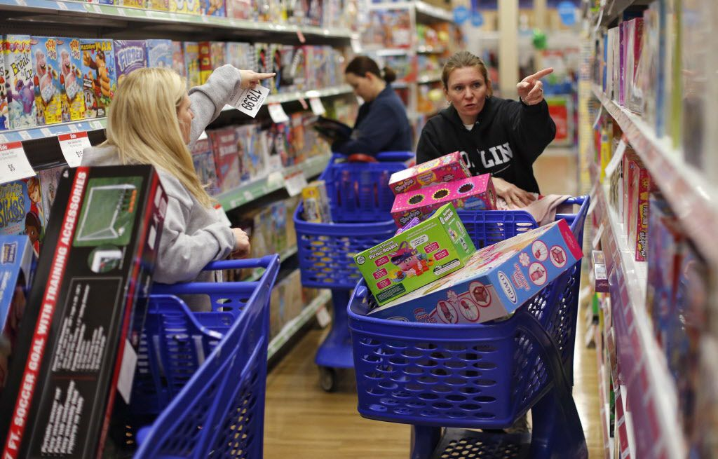 """Cousins Stacy Levine, left, and Melissa Bragg shop at the Toys""""R""""Us store in Atlanta on Black Friday, Nov. 27, 2015. The store opened on Thanksgiving day, and stayed open all night."""